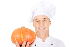 Male chef with a pumpkin Royalty Free Stock Photography