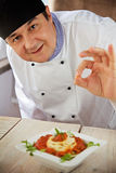 Male chef in restaurant Stock Photo