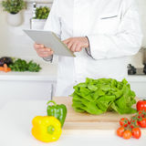 Male chef searching for recipe Royalty Free Stock Photo