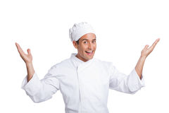Male chef smiling isolated on white. Male chef smiling and making hand  gesturing isolated on white Royalty Free Stock Photo