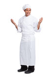 Male chef smiling and making hand  gesturing i Royalty Free Stock Image