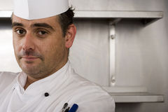 Male chef standing in commercial kitchen, close-up, portrait Royalty Free Stock Photography