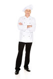 Male chef standing with folded arms. Restaurant experienced chef standing with folded arms Stock Image
