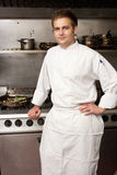 Male Chef Standing Next To Cooker. In Restaurant Kitchen stock photos