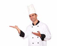 Male chef standing with palms open Stock Images