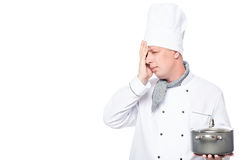 Male chef upset spoiled a dish on a white Stock Photography