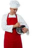 Male chef with whisk and mixing bowl Stock Photography