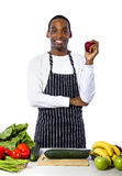 Male Chef on a White Background. African American male chef wearing an apron cooking isolated on a white background Stock Photography