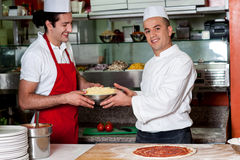 Male chefs in kitchen at work Royalty Free Stock Photo