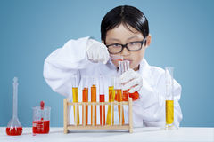 Male chemist doing research with chemical fluid. Portrait little chemist making chemistry research with chemical fluid and test tube Stock Photos