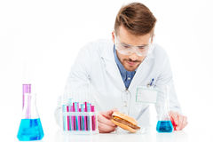 Male chemist making GMOs food. Isolated on a white background Stock Photography