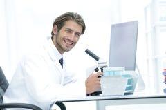 Male Chemist Scientific Reseacher using Microscope in Laboratory Royalty Free Stock Photo