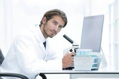 Male Chemist Scientific Reseacher using Microscope in Laboratory Stock Photos
