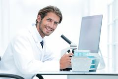 Male Chemist Scientific Reseacher using Microscope in Laboratory Royalty Free Stock Photography