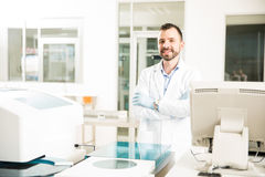 Male chemist working in a modern lab Stock Images