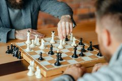 Male chess players playing, thinking process royalty free stock image