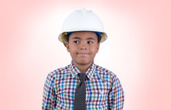 Male child in hard hat looking over Stock Photo