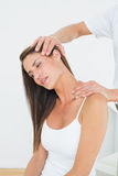 Male chiropractor doing neck adjustment stock photos