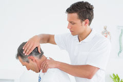 Male chiropractor doing neck adjustment Royalty Free Stock Photos