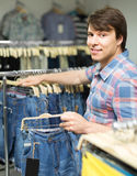 Male chooses jeans at clothing store Stock Image
