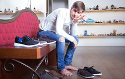 Male chooses winter shoes in a shoe store Stock Image