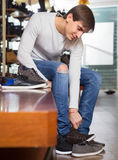 Male choosing summer shoes. In a shoe shop Royalty Free Stock Photo