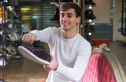 Male choosing summer shoes. In a shoe store royalty free stock photo