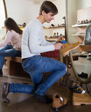 Male choosing winter shoes. In a shoe store royalty free stock photos
