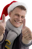Male with christmas hat showing thumb up Stock Photography