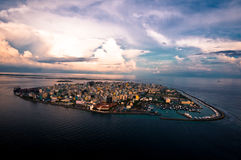 Male city. Scenic aerial view of sunset over Male city, Republic of Maldives Stock Photos