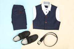 Male classic suit. And accessories on blue and beige background. Concept school uniform Stock Images