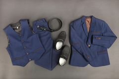 Male classic suit. Male classical suit on black background. Concept school uniform Stock Image