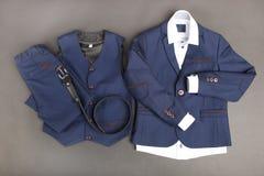 Male classic suit. Male classical suit on black background. Concept school uniform Stock Photo
