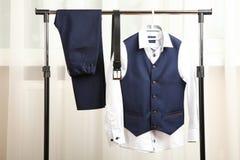 Male classic suit. Male classical suit on hanger. Concept school uniform Stock Image