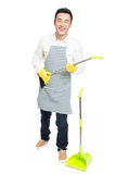 Male cleaner. Chinese male with cleaning sweep, white background Royalty Free Stock Images
