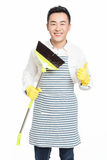 Male cleaner. Chinese male with cleaning sweep, white background Royalty Free Stock Photo