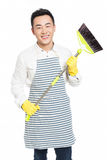 Male cleaner. Chinese male with cleaning sweep, white background Royalty Free Stock Photography