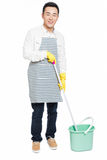 Male cleaner. Chinese male with cleaning sweep, white background Stock Photo