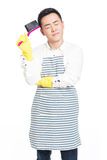 Male cleaner. Picture of male with cleaning sweep, white background Royalty Free Stock Photo