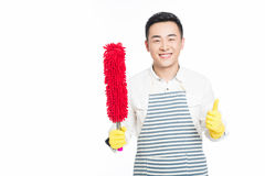 Male cleaner. Picture of male with cleaning sweep, white background Royalty Free Stock Image
