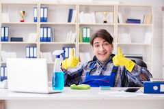 The male cleaner working in the office Royalty Free Stock Images
