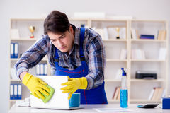 The male cleaner working in the office Stock Images