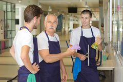 Male cleaning team on indoor job. Male Stock Photography
