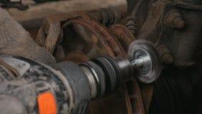 Male Cleans rust brake electric drill caliper before replacing the wheel. Male Cleans rust brake electric drill caliper before replacing the wheel stock video