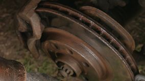 Male Cleans rust brake electric drill caliper before replacing the wheel. Male Cleans rust brake electric drill caliper before replacing the wheel stock video footage