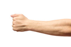 Male clenched fist isolated on white. Male clenched fist, isolated on a white background Royalty Free Stock Images