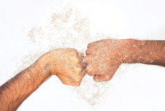 Male clenched fists with water splash Royalty Free Stock Photo