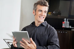 Male Client With Digital Tablet In Salon Royalty Free Stock Photo