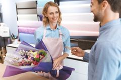 Florist and client with credit card Royalty Free Stock Image