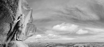 Male climber climbing big boulder in nature with rope Royalty Free Stock Photos